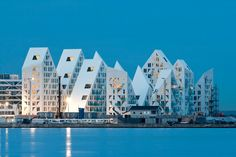 on the horizon for Iceberg, a jagged residential community in Aarhus by an impressive collaborative including CEBRA, JDS/Julien De Smedt Architects, SeARCH, Louis Paillard.
