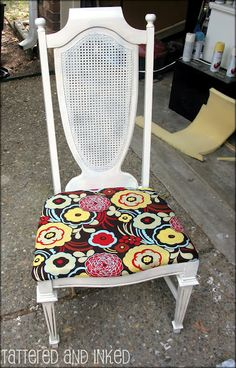 I covered my dining room chairs with the same fabric i used to make curtains.  Looks sooo good.