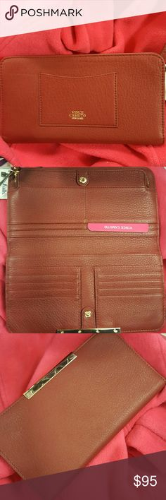Vince Camuto Tina wallet in burgendy This is a brand new, never used wallet with tags. It is a gorgeous burgendy color with gold accents. Authentic wallet made of genuine leather. No trades. Vince Camuto Bags Wallets