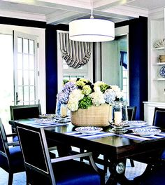 dining room. Love the dark blue walls with espresso table.