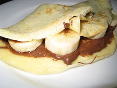 Ingredients:  1 freshly made crepe  1 tablespoon nutella  1 banana (sliced)    Directions:  1. Spread the nutella on the crepe, add the banana and enjoy.
