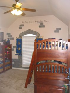 Knight/Medieval themed boys' room. If the ceiling fan was changed and there was a mural, this room would be perfect