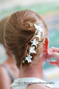 There are many ways to wear your hair on your wedding day. This is a cute wedding day hairstyle idea for the bride with flowers in her hair by Black Forest Photography http://www.blackforestphoto.com
