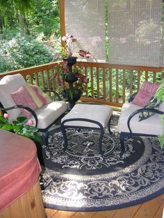 Small seating area on the porch by the hot tub.
