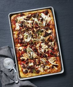 The truly genius element of this pizza isn't its cheesy layers of fresh parmesan and mozzarella. Or the hot Italian sausage that gets baked in bubbling tomato sauce until it's crispy on top, but still juicy inside.