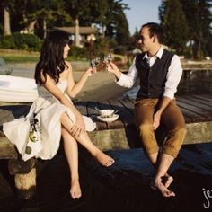 sweet engagement session that started at pike place market, moved to the kitchen and then out to enjoy together on the dock by jenny gg