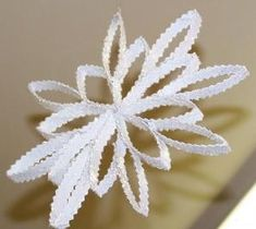 Snowflakes from Toilet Paper Rolls. by annette