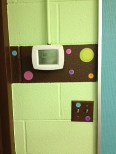 Polka dot stickers from Dollar Tree on wall. Forget about painting a perfect circle!
