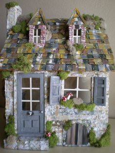 This was my very first custom dollhouse that I ever built. A french stone cottage.