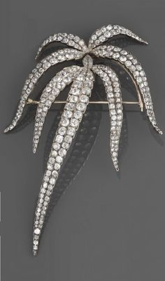 An early Victorian diamond spray brooch, circa 1850, composed of elongated fronds, each pave set throughout with cushion shaped old brilliant cut and old cut diamonds, approximately 12.00 carats total, mounted in gold backed silver, 10.1cm long, in a grey leather bound gilt tooled Longham & Strong Ltd, Piccadilly fitted case. #Victorian #brooch
