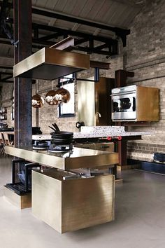 www.stainlesssteeltile.com loves this stainless steel, modern kitchen- The Kitchen Designer