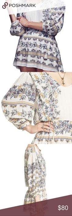 NWT FREE PEOPLE MOONLIGHT DRIVE PRINT MINIDRESS Details & Care Tassel-tipped ties nip in the waist of this flirtatiously short frock, while swirling floral prints add carefree, bohemian style. Scooped neck. Three-quarter sleeves. Drawstring waist. Lined. 100% rayon. Machine wash cold, line dry. By Free People; imported. Free People Dresses Mini
