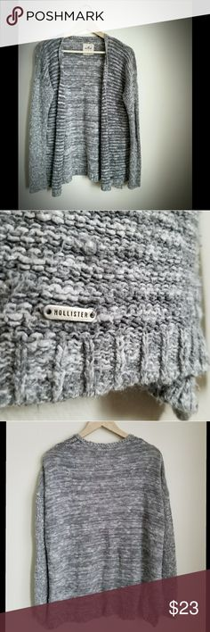 Gray M/L Hollister Knit Cardigan Good Condition Heathered Gray M/L Hollister Cardigan Sweater. Good pre-owned condition, supersoft, fuzzy & cozy. 55% Cotton, 45% Acrylic. Gray cardigans are a staple for me; they work with so many outfits! Just downsizing my collection. Thanks for looking 😊 Hollister Sweaters Cardigans