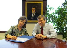 Mrs. Donna Massay and Director Dr. Talis Colberg signed the final paperwork establishing the Glenn Massay Endowed Scholarship for students at Matanuska-Susitna College. In the background is the official university portrait of former College Director Glenn Massay who passed away in February. Mrs. Massay created the $25,000.00 scholarship in memory of Dr. Massay.