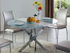 """ESF 2303 Dining Table - Ovale dining table. Material-metal legs, glass top. Dimensions: 39/51""""x 39""""x30""""."""