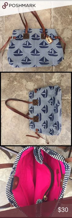 Dooney & Bourke shoulder bag. White and Navy striped outside with sailboat accents. Inside is hot pink. Length: 16.5 inches. Height: 11.5 inches. Width: 4.5 inches. Used, good condition. Small stain on one side. Will post more pictures if needed. Dooney & Bourke Bags Shoulder Bags