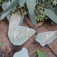 Sea glass place cards... these would be cute. I like the gold against that color blue and how it pops on the warm wood