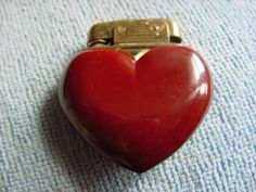 Someone please with Etsy type talent replicate this so I can buy it just because its effing cute!!!!   (WW2 _ ANTIQUE FRENCH _ BAKELITE _ HEART SHAPED _LIGHTER)