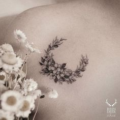 Garden-inspired tattoo by Zihwa. Zihwa blackwork subtle garden flower plant moon crescentmoon crescent
