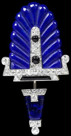 1920-30 Cliquet or surete pin, Cartier, NY.  Lapis lazulil, diamonds, black onyx and platinum. Would attach to lapel or front of cloche. V&A Museum