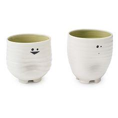 """These mugs remind me of my kids - one taller, slender, more serious one and one shorter, thicker, jolly one. Plus, my daughter calls my son """"Squisy Man"""" ... so I HAD to by the squishy mugs. Christmas present for myself. :-)"""