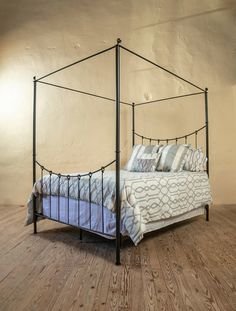 This wrought iron canopy bed frame queen from the Rose Bud collection is an elegant addition to any room with its graceful iron ties and minimalist feel, whether your decor consists of rustic, casual, western, or even contemporary elements. Iron Canopy Bed, Canopy Bed Frame, Canopy Bedroom, Master Bedroom, Rustic Canopy Beds, Wrought Iron Beds, Beds Online, How To Make Bed, Queen Beds