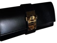 29e5b20be11 Get the trendiest Clutch of the season! The Herms Medor Black Leather Clutch  is a top 10 member favorite on Tradesy.