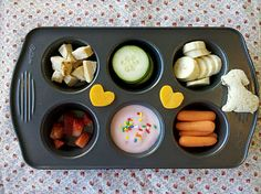 Give your kids their lunches in muffin tins..I do this with my kids quite a bit and they really like it!