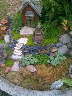 from Chalet in Wilmette - A Gnome Garden with a nice use of levels and stacked rocks and boulders