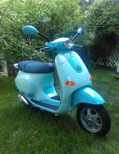 Vespa Scooter 2002 ET2 paint code 270 Cielo repainted with Spray Max aerosols 2K single stage urethane paint.