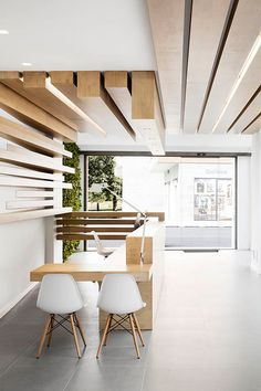 wood timbers + white | reception desk + lobby