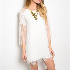 Stunning lace detail dress/tunic! Stunning white sheath dress with back tie and beautiful Victorian style 3 qtr lace sleeves with a scalloped lac hemline! Dresses