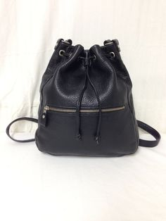 Gorgeous genuine black thick leather backpack by George Town    1 front zip pocket  Top cinch closure w/magnetic snap closure  Lined w/1 zip