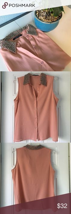 HP Light Pink Sleeveless with Beads Blouse This pink sleeveless blouse is perfect for an evening wear! It is very pretty with beads around the collar that will get you tons of compliments. It is 95% polyester and 5% spandex. Let me know if you're interested! Foreign Exchange Tops Blouses