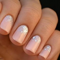 Cute wedding manicures you need. This short manicure with a sparkle gradient is a sweet option for any bride.