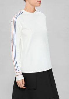 SADIE WILLIAMS Made from soft cotton blend, this classic-fit raglan sweater is detailed with metallic-knit stripes on the sleeves and stitching at hem.