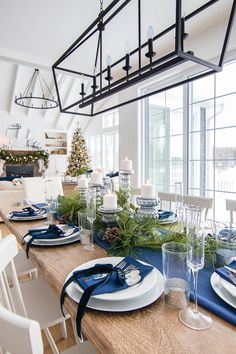 Silver and Navy Christmas Table Setting is part of Navy Living Room Christmas - Silver and navy Christmas table setting Navy tablecloth and napkins, glass candle holders, green garland and silver touches Classy Christmas, Coastal Christmas, Modern Christmas, Beautiful Christmas, Christmas Home, Christmas Trees, Cottage Christmas, Purple Christmas, Nordic Christmas