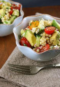 Fresh white corn, avocado, onion and tomato salad with cilantro vinaigrette.