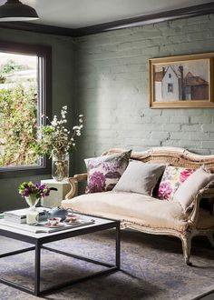 Floral cushions and blossoms in living room with green painted walls. Living Room Furniture Online, Home Furniture, Furniture Stores, Green Painted Walls, Floral Cushions, Decorating Your Home, Decorating Tips, Spring Home