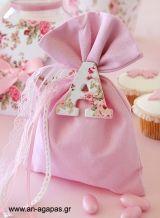 Μπομπονιέρα βάπτισης πουγκί μονόγραμμα φούξια-ροζ εμπριμέ