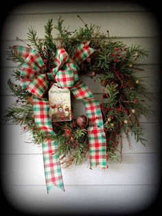 Rustic Pine Wreath- Bells and Bow - 24 by PrimitiveDesignsShop on Etsy https://www.etsy.com/listing/557197435/rustic-pine-wreath-bells-and-bow-24