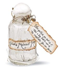 """A pretty mermaid has sent a bit of her magic dust ashore in an antique glass bottle. And according to the handwritten label, it's made especially for you. (Maximum 12 characters.) The mermaid even wrote an inspirational message: """"when you think you can't do it, take a big breath and do the impossible."""""""