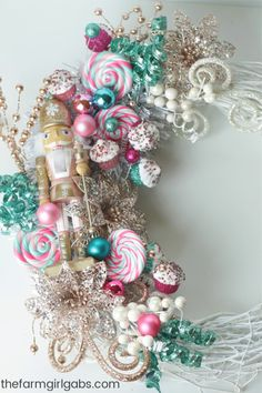This whimsical Nutcracker Wreath is an easy DIY craft you can make to celebrate the Christmas Season. This whimsical Nutcracker Wreath is an easy DIY craft you can make to celebrate the Christmas Season. Candy Land Christmas, Candy Christmas Decorations, Christmas Wreaths To Make, Pink Christmas, How To Make Wreaths, Holiday Wreaths, Christmas Crafts, Whimsical Christmas Trees, Christmas Wreath With Ornaments