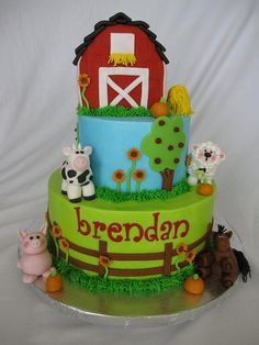 """Bottom layer: bright green w/fence. Top layer - sky, grass at base, tree/flowers, sunshine. Grassy """"barnyard"""" on top - animals, pond, etc."""