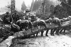 German troops removing roadblock in the Ardennes