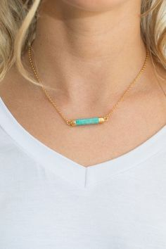 Shop our natural stone bar necklace. Available in coral, turquoise, and marble. Featuring an adjustable length. Always Free shipping on all US orders!