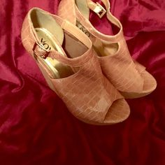 Open Toe Wedge xoxo sandals Cute brown open toe XOXO sandals wedges. Tan patent leather. 6 inch heel. Size 9 with adjustable strap. ( sorry can't find shoe size on shoe, it was on Label) XOXO Shoes Heels