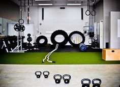 Nice Crossfit garage gym - lots of tires, ropes, plates... all of it