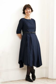 Really not keen on that style of shoes but what a lovely, practical dress! :)