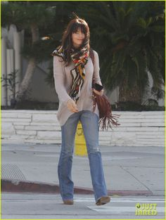 bootcut or flare jeans, neutral sweater, boots and bright scarf